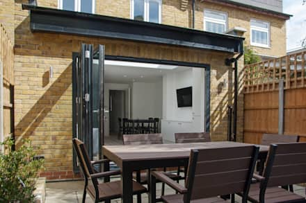 Rear extension:  Sliding doors by GK Architects Ltd