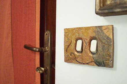 Copriprese 05: Spa in stile in stile Eclettico di Forgiatore di Elementi di Giuseppe Sautto