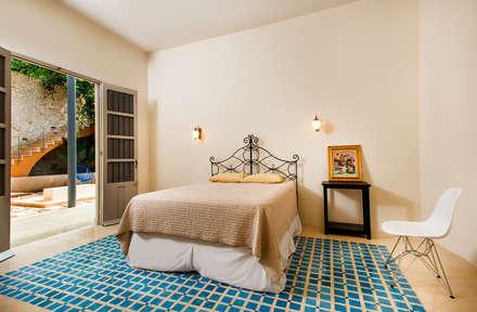 ห้องนอน by Taller Estilo Arquitectura