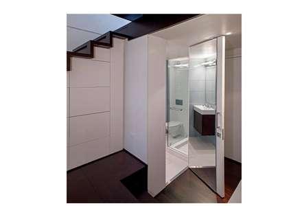 Manhattan Micro-Loft: modern Bathroom by Specht Architects