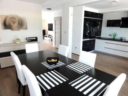 Dom w zabudowie szeregowej: styl , w kategorii Jadalnia zaprojektowany przez studio bonito