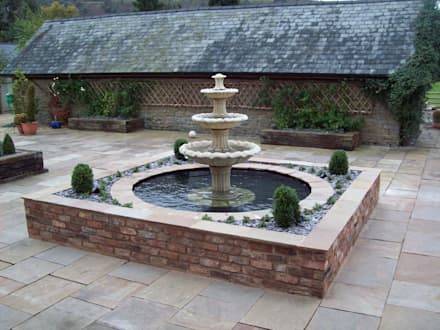 Stone Water Fountain: classic Garden by Unique Landscapes
