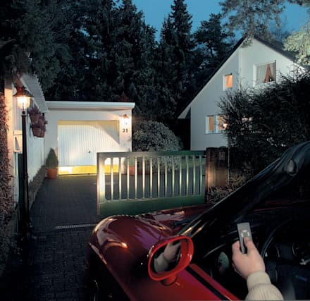 Automatic remote controlled steel sliding gates: eclectic Garage/shed by AGD Systems