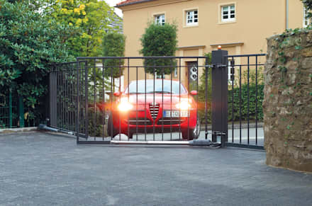 Automatic remote controlled steel swing gates: eclectic Garage/shed by AGD Systems