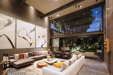 Casa Basaltica: Salas de estilo minimalista por grupoarquitectura