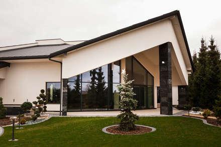 Rezydencja Orzech : styl nowoczesne, w kategorii Domy zaprojektowany przez tomasz czajkowski pracownia