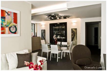 Zona pranzo: Sala da pranzo in stile in stile Moderno di Ignazio Buscio Architetto