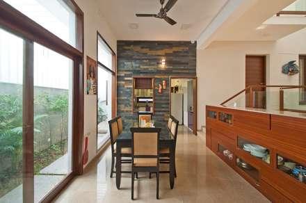 mr sajeev kumar s residence at girugambakkam, near m.i.o.t hospital, chennai ,tamilnadu: modern Dining room by Muraliarchitects