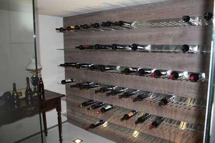 modern Wine cellar by MATTEONOFRINTERIORDESIGNER