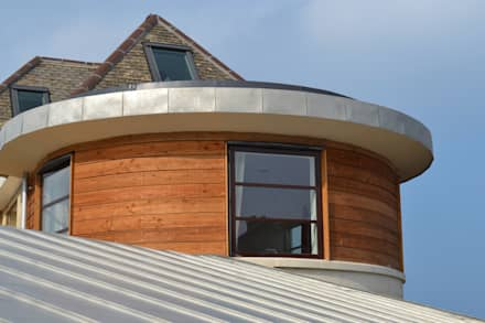 Curved master bedroom extension:  Country house by Hetreed Ross Architects