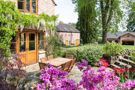 Patio: rustic Garden by Barnes Walker Ltd