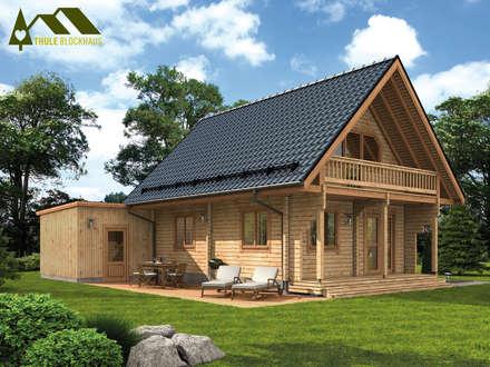 Ferienhaus Fjord mit Carport Terrasse: rustikale Häuser von THULE Blockhaus GmbH