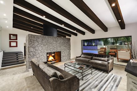 Sala: Salas de estilo moderno por Juan Luis Fernández Arquitecto