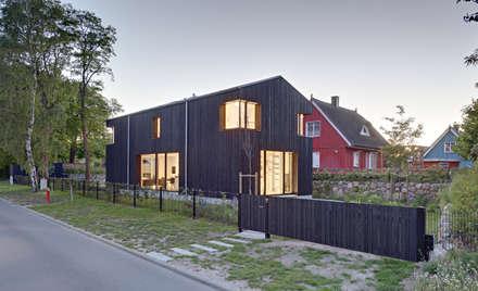 Techos a dos aguas de estilo  por Möhring Architekten