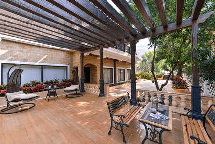 Veranda:  Terrace by ARK Reza Kabul Architects Pvt. Ltd.