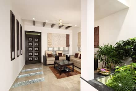Residence at Kerala : eclectic Living room by Sanskriti Architects
