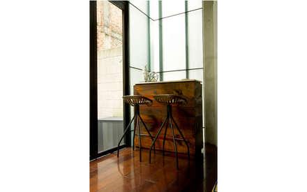 industrial Living room by Ploka 8.7