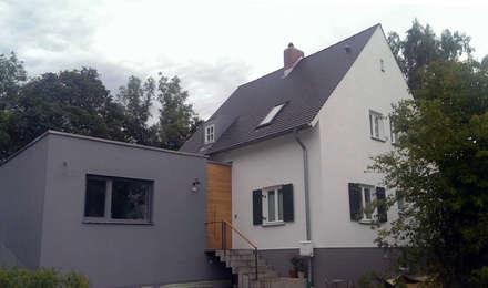 Wohnhaus Grüne Mitte Regensburg: moderne Häuser von Donhauser Postweiler Architekten