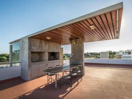 Terrazas modernas ideas im genes y decoraci n homify for Jacuzzi casa moderna