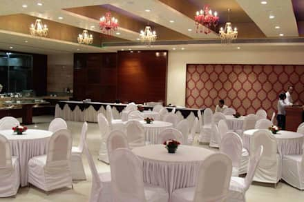 Banquet hall:  Exhibition centres by Ishita Joshi Designs - Love Living!