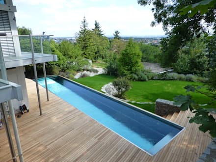 Garten in der Thermenregion: moderner Pool von BEGRÜNDER