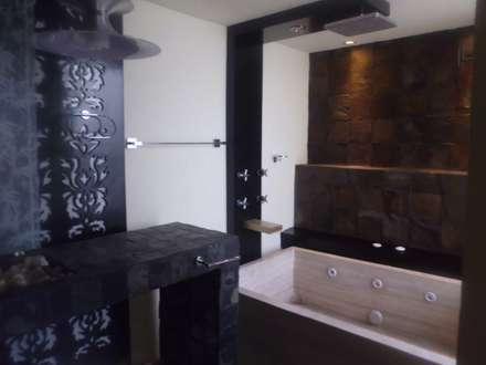 baño eclectico: Baños de estilo  por bello diseño interior