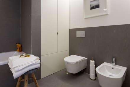 Casa de banho da suite do Casal: Casas de banho modernas por Traço Magenta - Design de Interiores