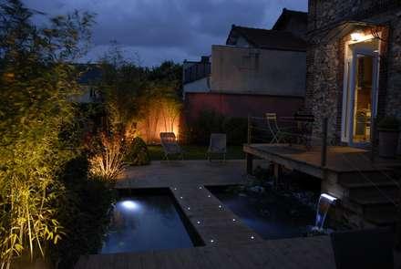 Jardin d'eau sur pilotis de bois et cuisine d'été: Jardin de style de style Moderne par Taffin