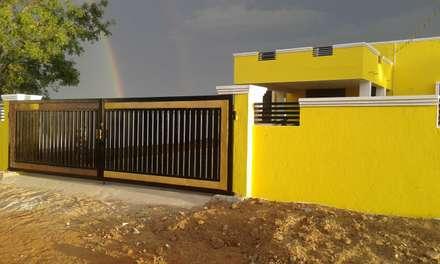 Entrance gate:  Windows by NISHA MIDAS CONSTRUCTION