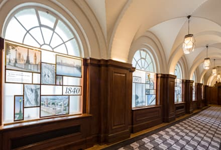 Entrance hallway lined with historical display panels:  Commercial Spaces by Goddard Littlefair