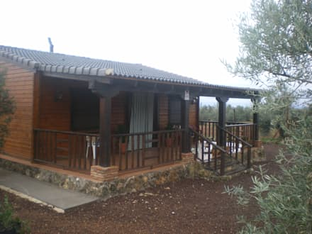 Casa de Madera 2: Casas de madera de estilo  de Dimumarco SLU