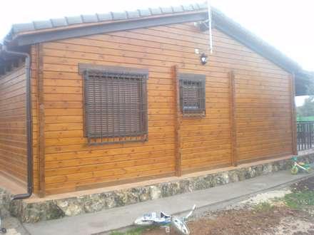 Casa de madera: Casas de madera de estilo  de Dimumarco SLU