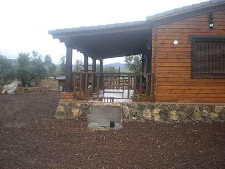 Porche: Casas de madera de estilo  de Dimumarco SLU