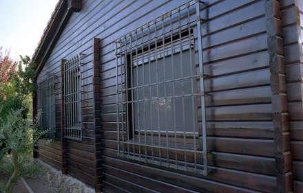 Construcción Casa de Madera a Medida: Casas de madera de estilo  de Dimumarco SLU