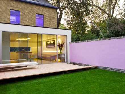 Slim framed sliding glass doors to Russell Garden Mews:  Terrace by IQ Glass UK
