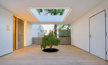 Lichthof Haus am See: moderne Häuser von Bau-Fritz GmbH & Co. KG