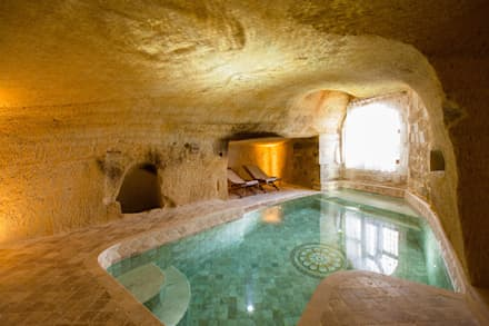 Piscinas de estilo  por Kayakapi Premium Caves - Cappadocia