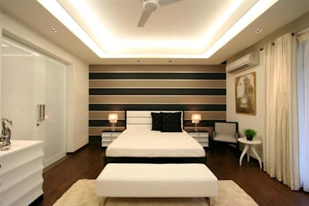 Apartment: modern Bedroom by Saloni Design