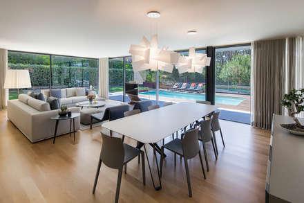 AM 2014 - Fão: Salas de jantar modernas por INAIN Interior Design