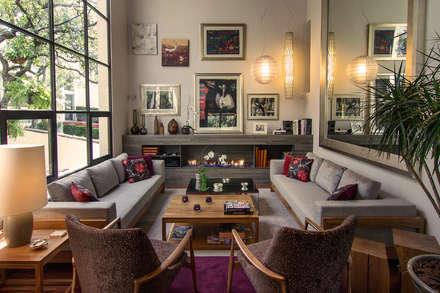 Salón Casa JM: Salas de estilo moderno por Weber Arquitectos