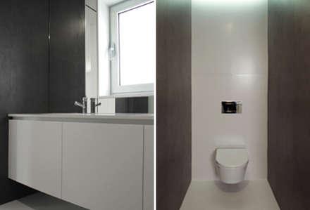 Apartamento em Trandeiras, Braga: Casas de banho minimalistas por ASVS Arquitectos Associados