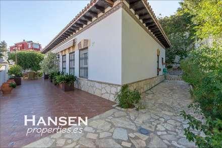 fachada: Casas de estilo  por HansenProperties