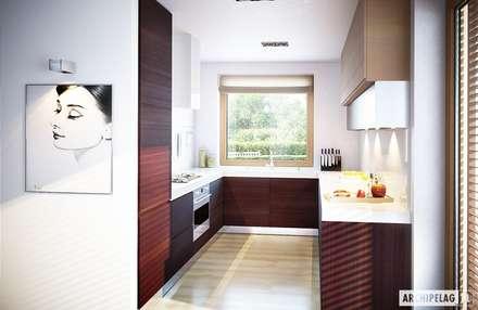 Projekt domu Kornel VI (z wiatą) ENERGO | kuchnia : styl , w kategorii Kuchnia zaprojektowany przez Pracownia Projektowa ARCHIPELAG