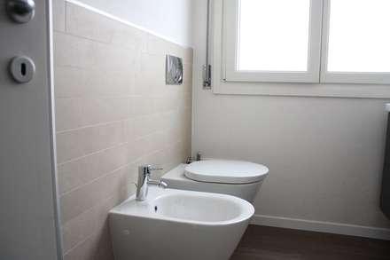 Codice Casa: Bagno in stile in stile Minimalista di g.n.(A) giorgio nadile Architetto
