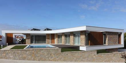 Moradia em Caldas da Rainha: Habitações  por SOUSA LOPES, arquitectos