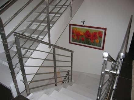 CASA SOLE: Ingresso & Corridoio in stile  di STUDIO ABACUS di BOTTEON arch. PIER PAOLO
