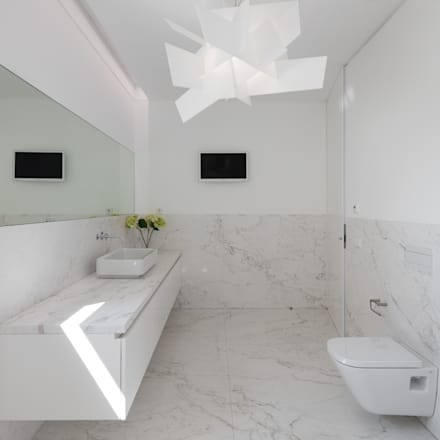 Casa Touguinhó II: Casas de banho minimalistas por Raulino Silva Arquitecto Unip. Lda