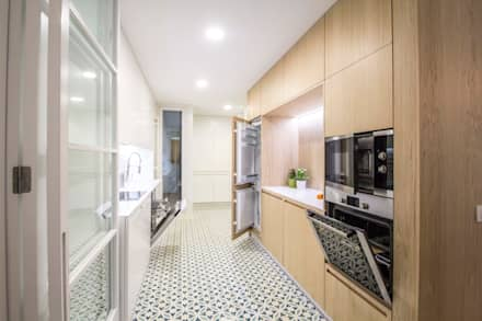 REFORMA DE VIVIENDA EN CALLE BURRIANA (VALENCIA): Cocinas de estilo minimalista de DonateCaballero Arquitectos