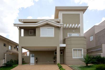 Residencia  Ribeirão Preto : Casas ecléticas por Luciano Esteves Arquitetura e Design