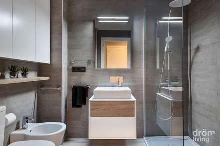 Hogar familiar en Badalona: Baños de estilo clásico de Dröm Living